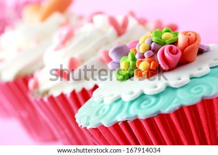 close up of beautiful colorful wedding cupcakes - stock photo