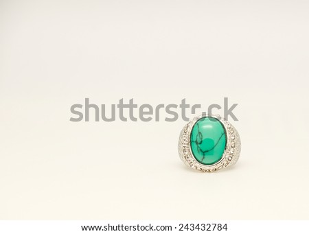 Close up of beautiful green stone silver ring with diamond for gift or present for special someone - stock photo