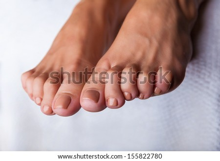 Close-up of beautiful manicured feet with pedicure - stock photo