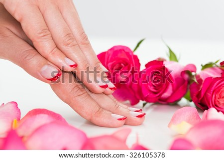 Close-up Of Beautiful Manicured Woman Hands With Roses
