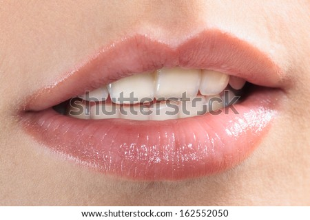 close up of beautiful mouth lips teeth smile smiling caucasian woman