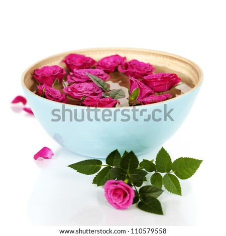 Close up of Beautiful pink roses in bowl over white - stock photo