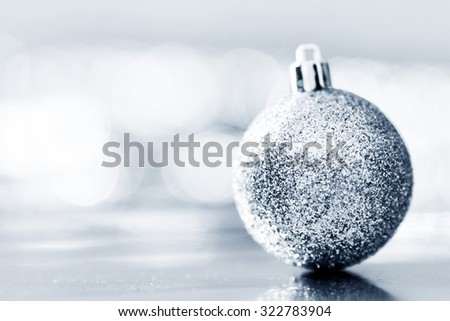 Close-up of beautiful silver glitter christmas decorative ball - stock photo