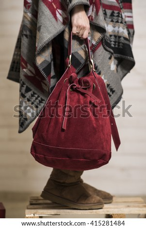 Close-up of beautiful suede red handbag