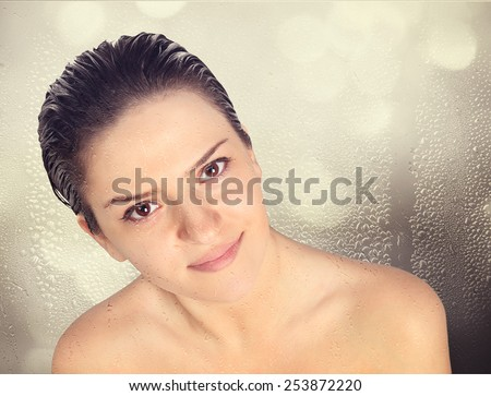 Close-up of beautiful wet woman face with water drop