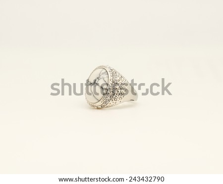 Close up of beautiful white stone silver ring with diamond for gift or present for special someone - stock photo