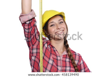 Close up of beautiful woman construction worker taking measures with a measuring tape Isolated white background. - stock photo