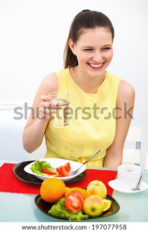 Close-up Of Beautiful Woman Eating healthy food - stock photo