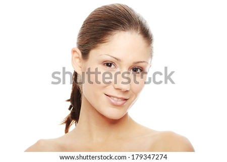 Close-up of beautiful woman face, over white background  - stock photo