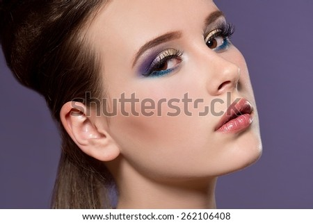 Close-up of beautiful woman face with colorful make-up and lips  - stock photo