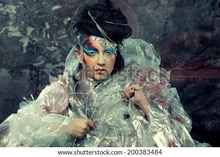Close-up of beautiful woman face with creative fashion art make up.Studio shot. - stock photo