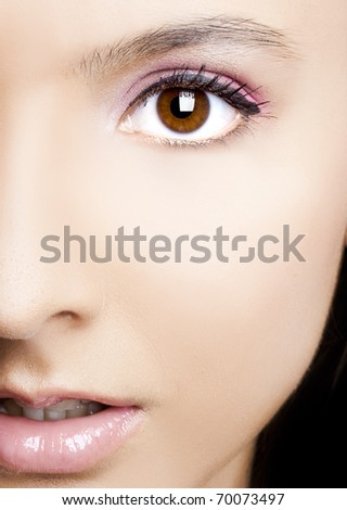 Close-up of beautiful woman face with perfect makeup - stock photo