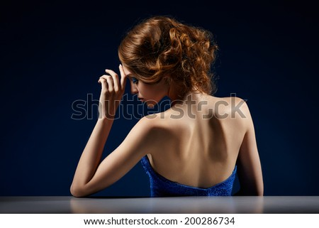 close up of beautiful woman in evening dress, bar table - stock photo