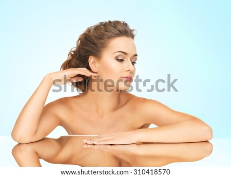 close up of beautiful woman lying on the mirror - stock photo