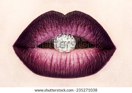 Close-up of beautiful woman's lips. Macro lipgloss cherry make-up. Mouth with wedding diamond jewelry - stock photo