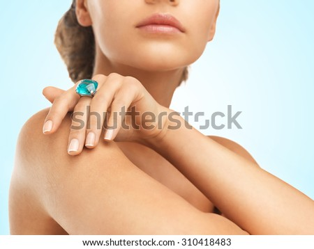 close-up of beautiful woman with cocktail ring