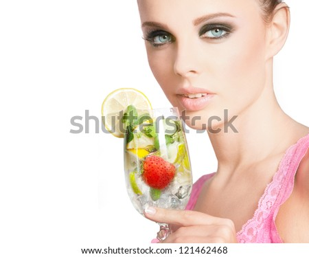 Close-up of beautiful woman with wineglass of cocktail  on white background - stock photo