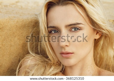 Close up of beautiful young blonde woman.  Professional make-up, hair style and styling.