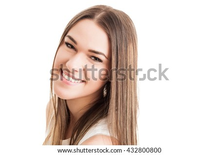 Close-up of beautiful young woman looking at the camera and smiling isolated on white with advertising area - stock photo