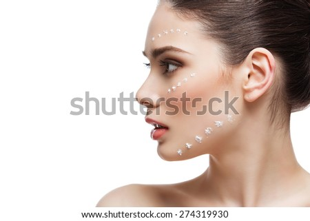 Close up of beautiful young woman profile with cream dots on face. Isolated. Copy space - stock photo