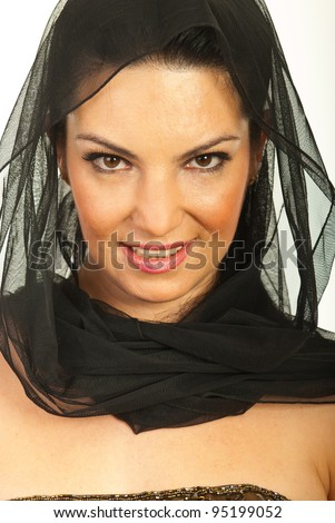 Close up of beauty woman face wearing black veil on head and smiling
