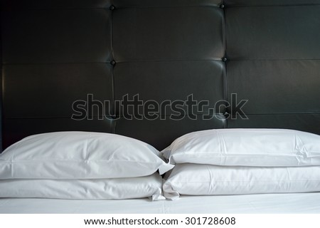 close up of bed in a business hotel room - stock photo