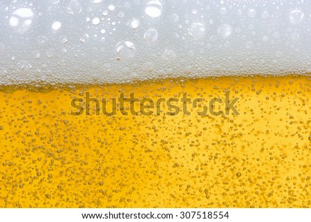 Close Up of Beer Foam and Froth. For Background Use - stock photo
