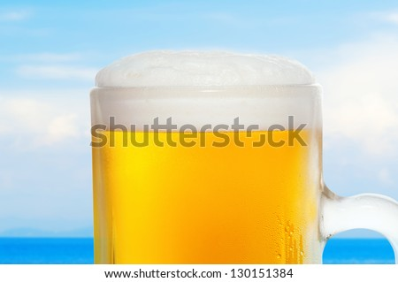 Close-up of beer in the background of the blue sky