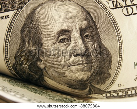 Close-up of Benjamin Franklin on the $100 bill. Finance concept. - stock photo