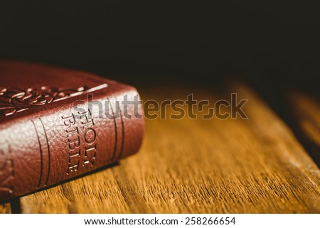 Close up of bible on wooden table - stock photo