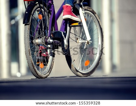 Close up of bicyclist in the evening - stock photo
