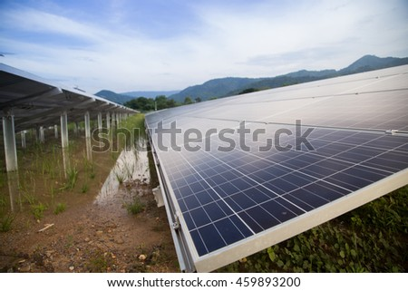 Close up of big solar panel in solar farm with blue sky.Alternative and clean energy concept.