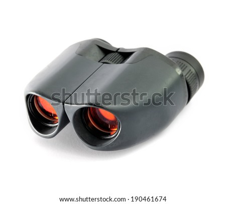 Close up of binoculars isolated on white background, selective focus. - stock photo
