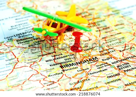 Close up of  Birmingham ,United Kingdom  map with airplane  toy and  red pin - Travel concept  - stock photo