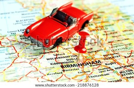 Close up of  Birmingham ,United Kingdom  map with red pin and car - Travel concept  - stock photo