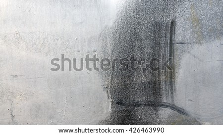 Close up of black and white paint on grungy metal surface 16:9