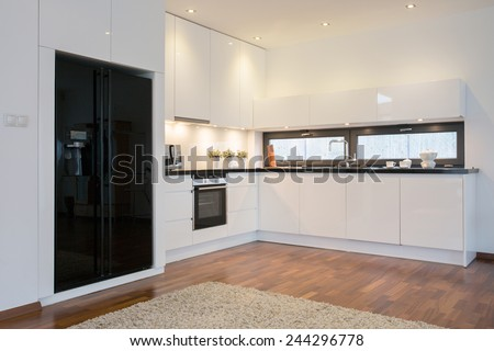 Close-up of black fridge in bright kitchen