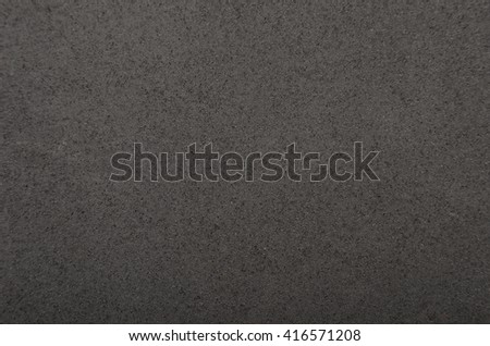 Close up of black polystyrene textured foam background - stock photo