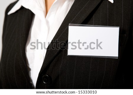 close up of black suit with id card