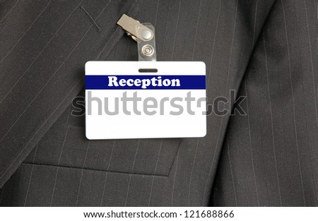 Close Up of Black Suit with Reception ID Card