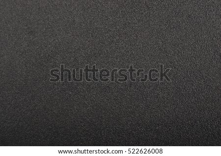 Close up of black textured plastic background