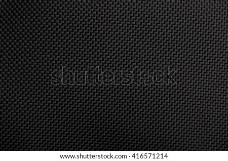 Close up of black textured synthetical backgroun - stock photo