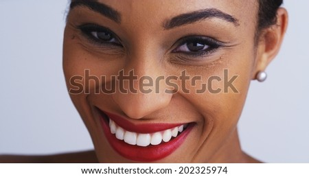Close up of black woman with a great smile - stock photo