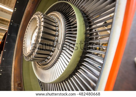 Close up of blades in an airplane engine during maintenance
