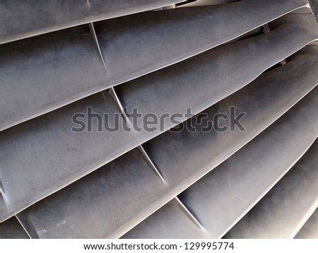 Close-up of blades of a jet engine. - stock photo