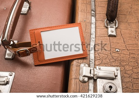 Close up of blank luggage tag on suitcases   - stock photo