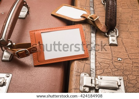 Close up of blank luggage tags on suitcases   - stock photo