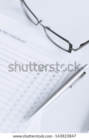 close up of blank questionnaire or form with eyeglasses