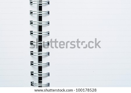 Close-Up of blank spiral dot line white note background