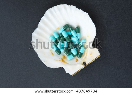 Close up of blue and green capsules, medicine antibiotic - stock photo